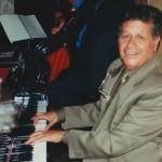 Noro (Luis Antonio) Bastidas, professional pianist, concert timpanist, oboist, guitarist, singer in Santa Fé de Bogotá, Colombia, South America. (Noro Bastidas is the father in law of Demetrios Kastaris).