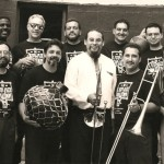 The Latin-Jazz Coalition, led by Demetrios Kastaris with special invited Jazz virtuoso guests, Steve Turre on trombone and conch shells, and Claudio Roditi, trumpet and flugelhorn, Seuffert Bandshell, Forest Park, Woodhaven, Queens, New York. June 26, 1993, Photo by Kathy Izzo.