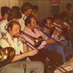 The trend setting, world famous Stan Kenton Jazz Orchestra trombone section in 1976. Dick Shearer, lead trombonist in the middle.