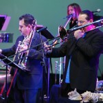 Demetrios Kastaris plays with Steve Turre, top row, flautist Connie Grossman, Queens Theatre in the Park, Flushing, New York, December 17, 2004, photo by Jerry Lacay.