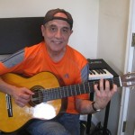 "John Diaz recording the nylon string guitar parts for ""Gracias mi Señor"" for the CD ""Te Exaltamos con Trombones"" in his studio in Denville, New Jersey."