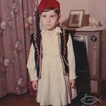 Demetrios, dressed in a Greek Evzone costume for Greek Independence Day, Lorain, Ohio, around 1963. The tradition practiced by Greek Americans is to have their children recite poetry about their Greek national pride in the church fellowship hall on Greek Independence Day dressed in traditional costumes, March 25 every year.