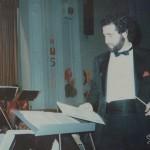 Demetrios conducting a String Orchestra concert, William Cowper Intermediate School 73, Maspeth, Queens, 1984.
