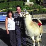 Hilda and Demetrios posing with a llama in Bogotá, Colombia, South America.